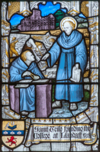 Stained glass window showing St Teilo with the building of Llandaff Cathedral.