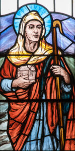 Image of St Teilo in stained glass.