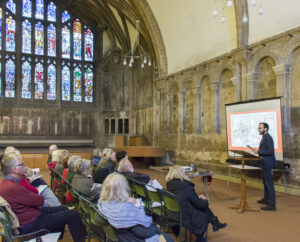 Francesco Marzella speaking in the Chapter House at Gloucester Cathedral.
